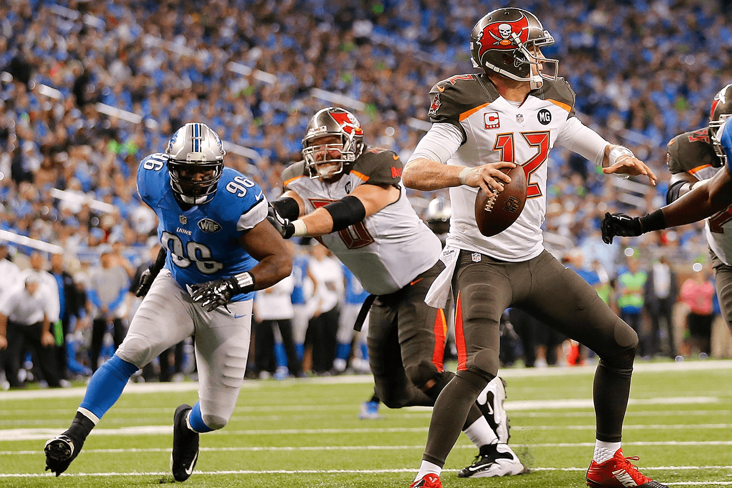Andre Fluellen of the Detroit Lions rushes Josh McCown of the Tampa Bay Buccaneers in 2014. (Leon Halip/Getty Images)