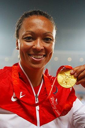 Hucles with her gold medal at the 2008 Olympics. (Cameron Spencer/Getty Images)