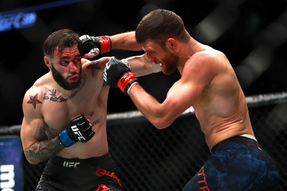 Calvin Kattar (r.) punches Shane Burgos in their featherweight bout at UFC 220 in January 2018.