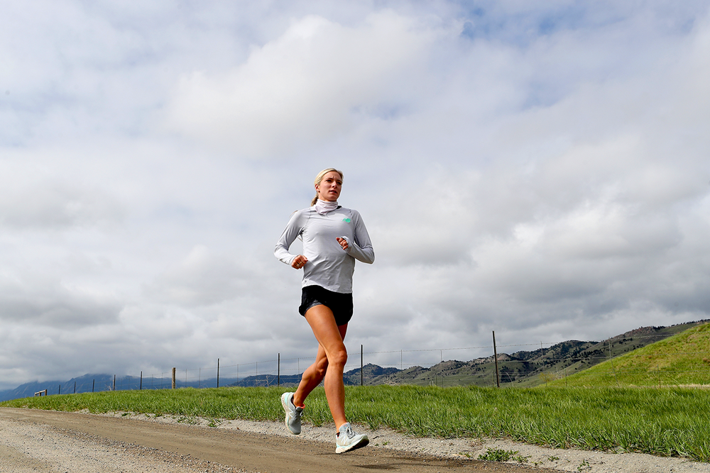 Training in isolation, Olympic steeplechase athlete Emma Coburn runs in Boulder, Colo. (Matthew Stockman/Getty Images)