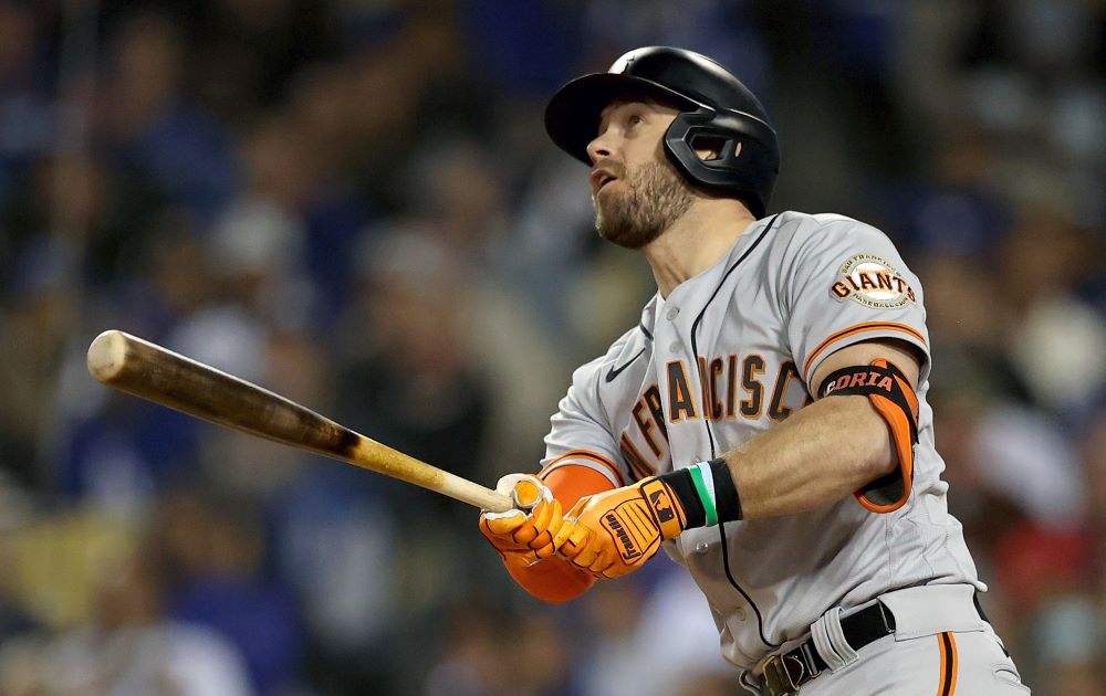Evan Longoria's solo home run somehow cut through the Dodger Stadium night to give the Giants a 1-0 win on Monday.