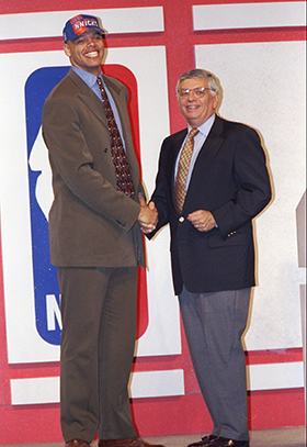John Thomas with NBA commissioner David Stern at the 1997 draft. (Craig Jones/Allsport/Getty Images)