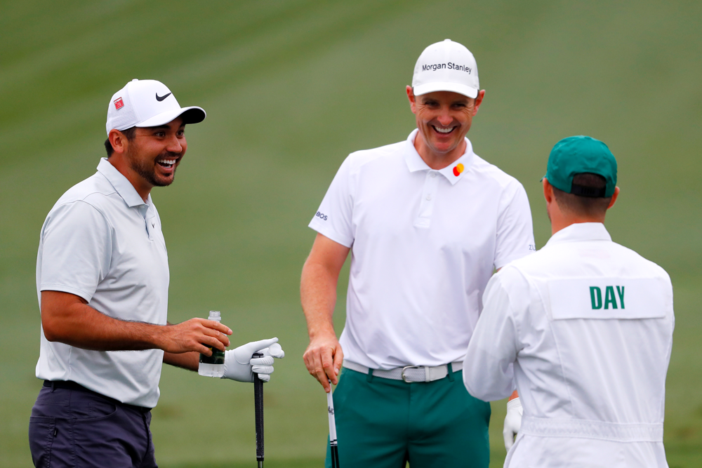 Jason Day (l.) and Justin Rose at the 2019 Masters tournament. (Kevin C. Cox/Getty Imag