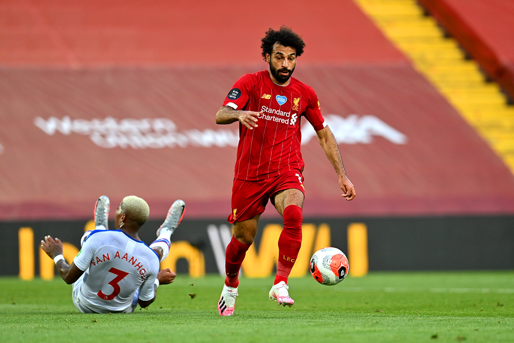 Mohamed Salah breaks free and goes on to score against Crystal Palace on June 24. (Paul Ellis/Getty Images)