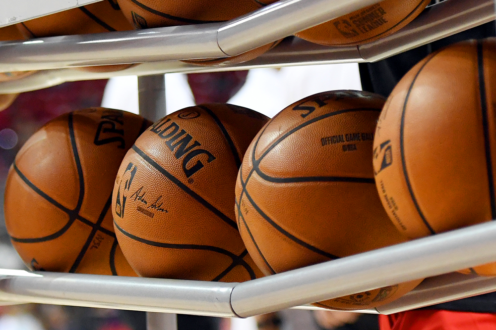 National Basketball Association players agree to 25% pay cuts