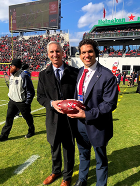 Sam (r.) with Oliver Luck.
