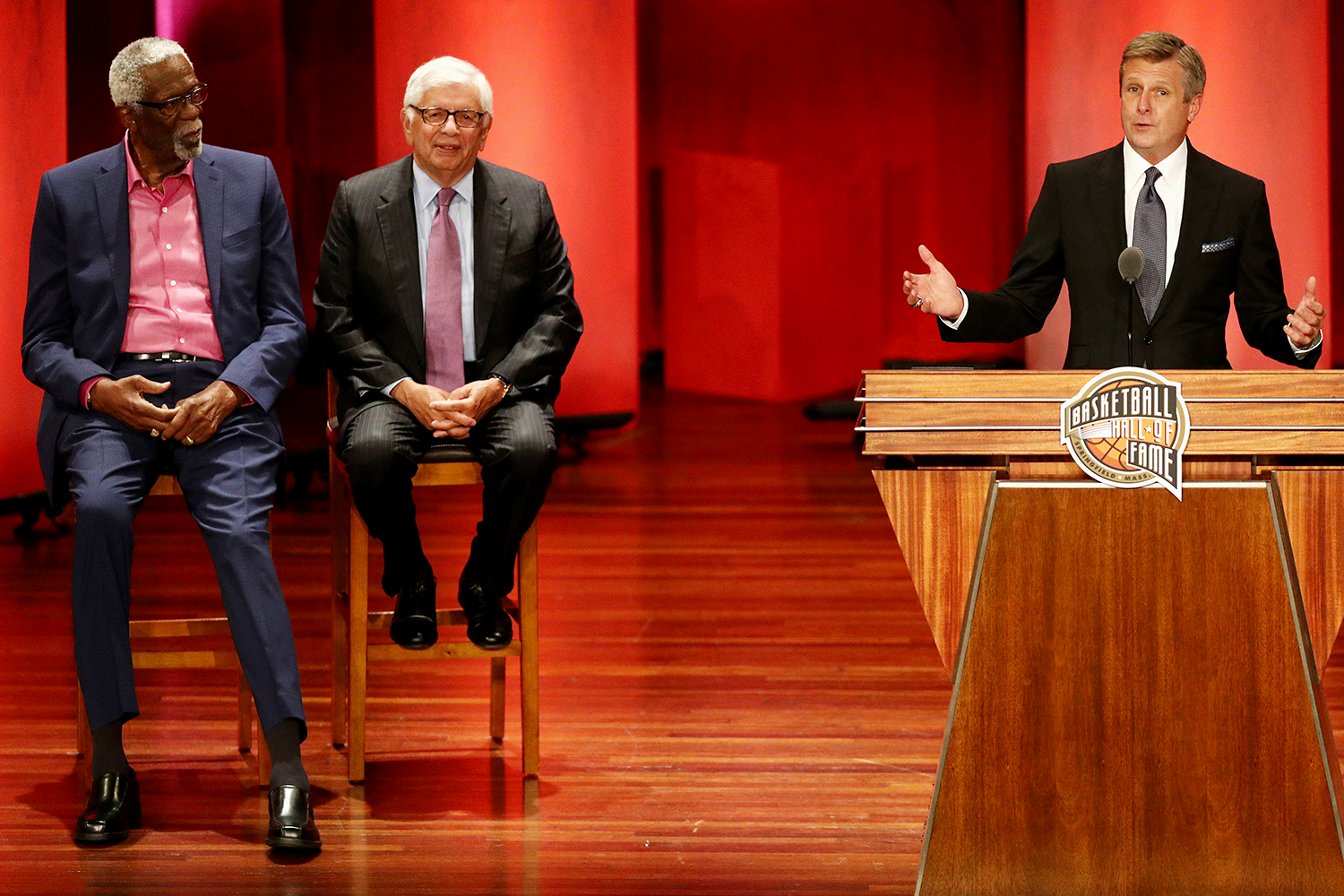 Rick Welts gives his Hall of Fame speech as Bill Russell (far l.) and David Stern look on in Sept. 2018 (Maddie Meyer/Getty Images).